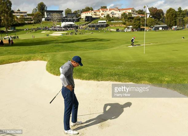 Jordan Spieth reacts to a shot out of the bunker on the 10th hole green during the final round of the Genesis Open at Riviera Country Club on...
