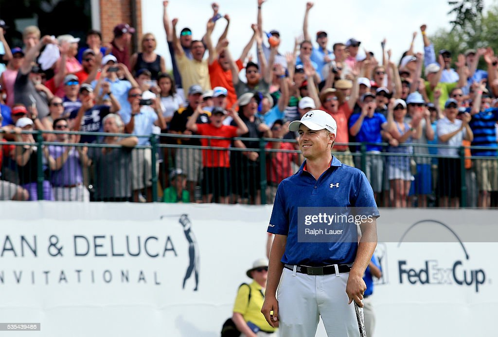 Jordan Spieth reacts to making a birdie putt on the 18th green to win the DEAN & DELUCA Invitational at Colonial Country Club on May 29, 2016 in Fort Worth, Texas.