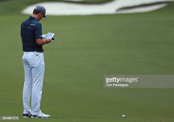 Jordan Spieth reads the yardage book on the first hole during the Third Round of the DEAN DELUCA Invitational at Colonial Country Club on May 28 2016...