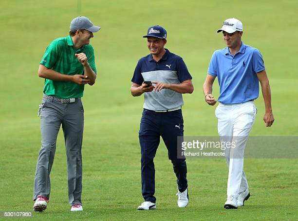 Jordan Spieth Rickie Fowler and Justin Thomas share a joke as they walk down a fairway during a practise round for THE PLAYERS Championship on The...