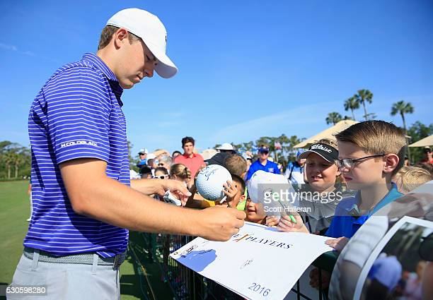 Jordan Spieth signs autographs for fans during a practice round prior to the start of THE PLAYERS Championship on the Stadium Course at TPC Sawgrass...