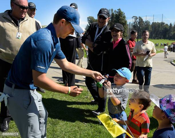 Jordan Spieth signs autographs for young fans on the third hole during the ProAm at the Genesis Open at Riviera Country Club on February 15 2017 in...