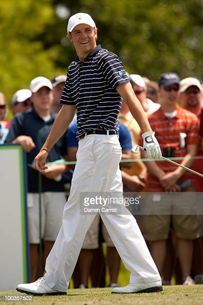 Jordan Spieth smiles in reaction to a tee shot during the fourth round of the HP Byron Nelson Championship at TPC Four Seasons Resort Las Colinas on...