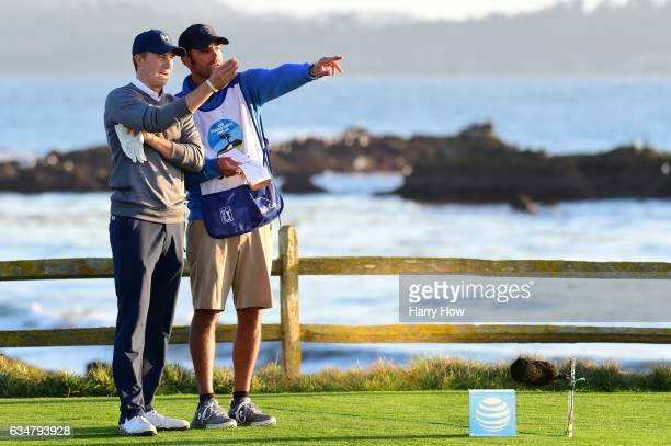 Jordan Spieth speaks with his caddie on the 18th hole tee during Round Three of the ATT Pebble Beach ProAm at Pebble Beach Golf Links on February 11...