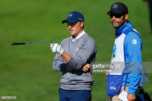 Jordan Spieth speaks with his caddie on the sixth hole during Round Three of the ATT Pebble Beach ProAm at Pebble Beach Golf Links on February 11...