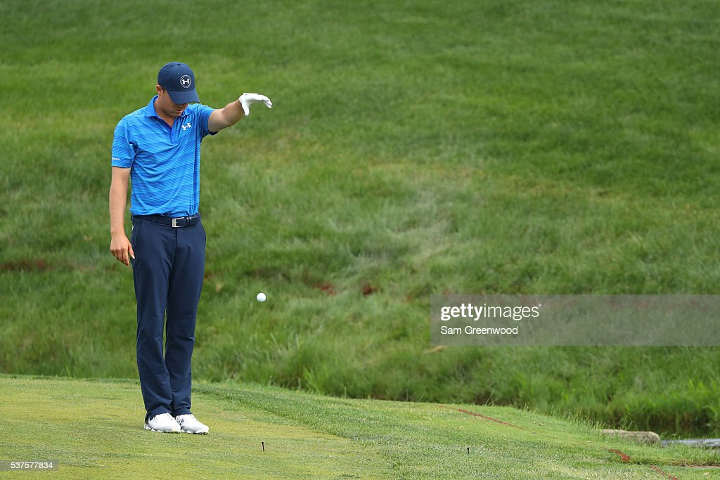 Jordan Spieth takes a drop on the 14th hole during the first round of The Memorial Tournament at Muirfield Village Golf Club in Dublin, Ohio, on June 2, 2016 in Dublin, Ohio.
