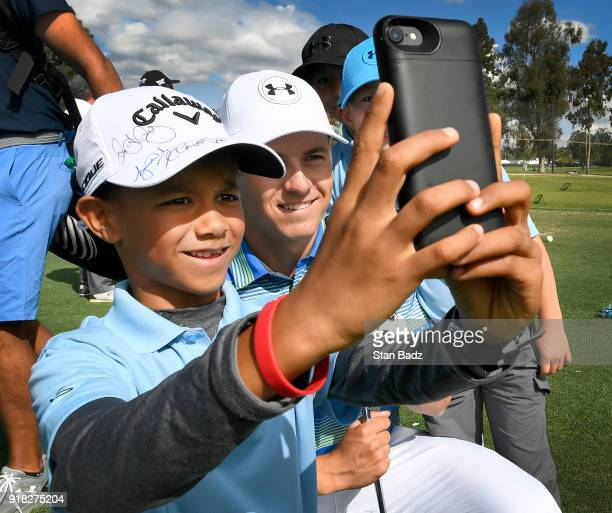Jordan Spieth takes a selfies with a young fan during the ProAm round for the Genesis Open at Riviera Country Club on February 14 2018 in Pacific...