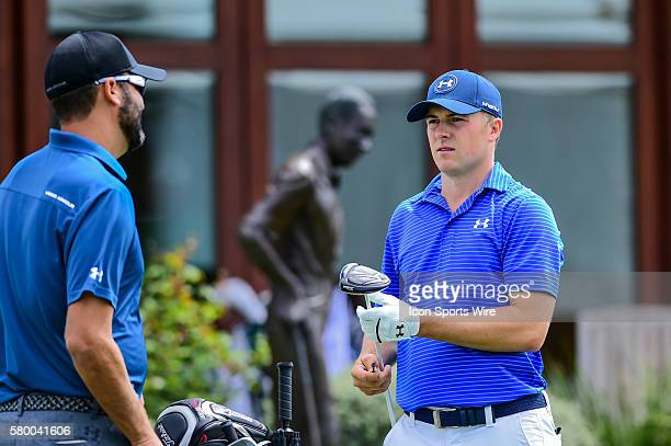Jordan Spieth talks to caddy Michael Greller on the driving range prior to the World Golf Championships Dell Match Play Round 1 at the Austin Country...