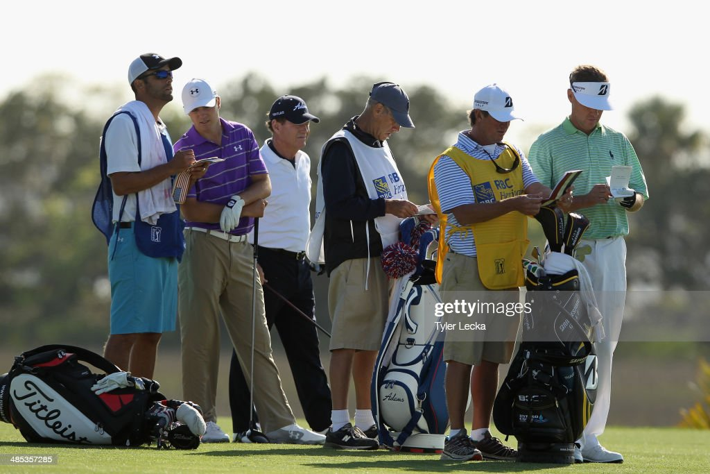 Jordan Spieth, Tom Watson, Davis Love III and their caddies assess a tee shot on the 18th hole during the first round of the RBC Heritage at Harbour Town Golf Links on April 17, 2014 in Hilton Head Island, South Carolina.