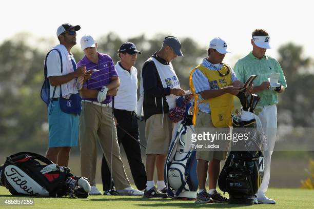 Jordan Spieth Tom Watson Davis Love III and their caddies assess a tee shot on the 18th hole during the first round of the RBC Heritage at Harbour...