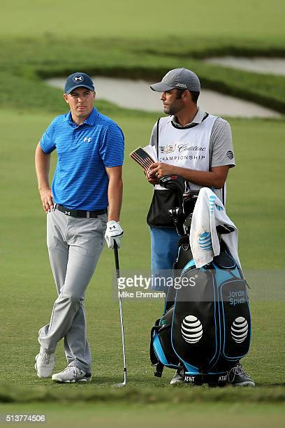 Jordan Spieth waits to take his shot with his caddie Michael Greller on the 16th hole during the second round of the World Golf ChampionshipsCadillac...
