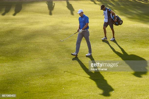 Jordan Spieth walks down the 16th hole fairway with his caddie Michael Greller during round two of the World Golf Championships Dell Technologies...