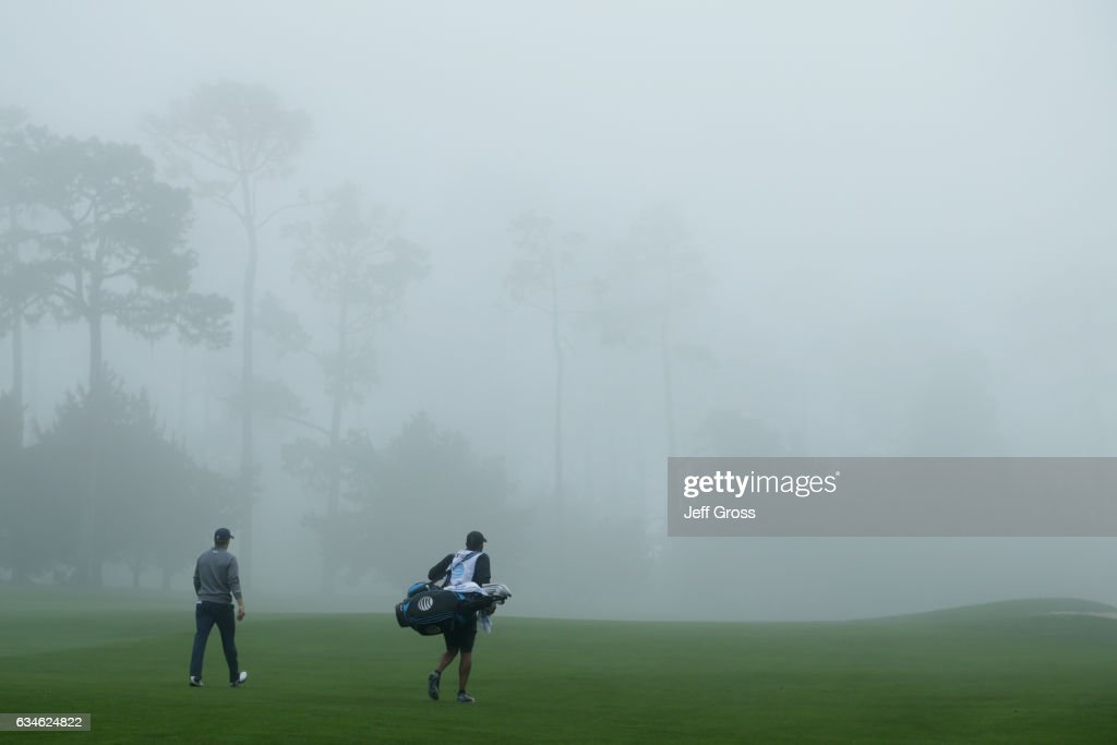 Jordan Spieth walks with his caddie on the 9th hole during Round Two of the AT&T Pebble Beach Pro-Am at Spyglass Hill Golf Course on February 10, 2017 in Pebble Beach, California.