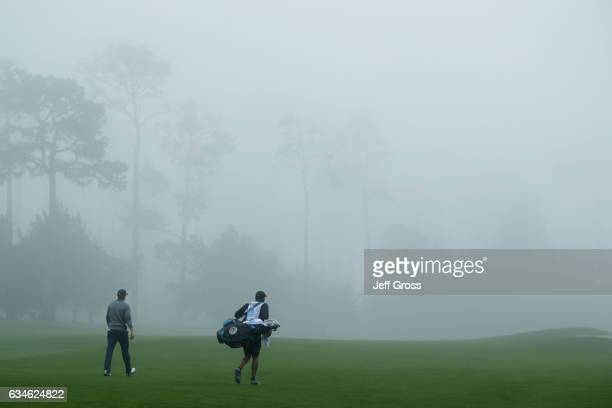 Jordan Spieth walks with his caddie on the 9th hole during Round Two of the AT&T Pebble Beach Pro-Am at Spyglass Hill Golf Course on February 10,...