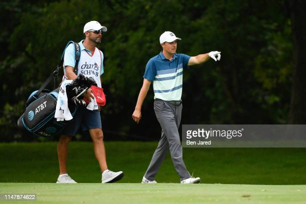 Jordan Spieth walks with his caddie on the seventh hole during the final round of the Charles Schwab Challenge at Colonial Country Club on May 26...