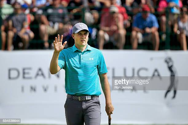 Jordan Spieth waves to the gallery after making a birdie putt on the ninth green during the First Round of the DEAN DELUCA Invitational at Colonial...