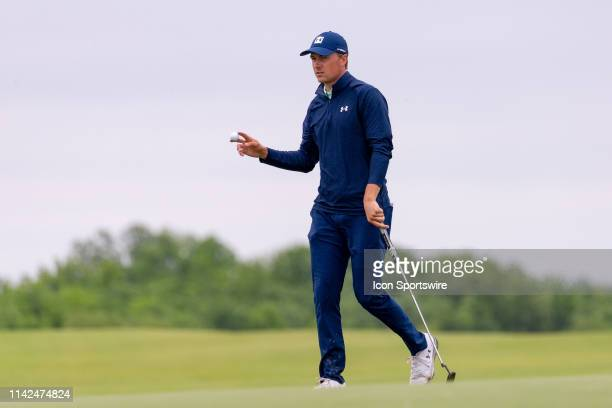 Jordan Spieth waves to the gallery from the 15th green during the first round of the ATT Byron Nelson on May 9 2019 at Trinity Forest Golf Club in...