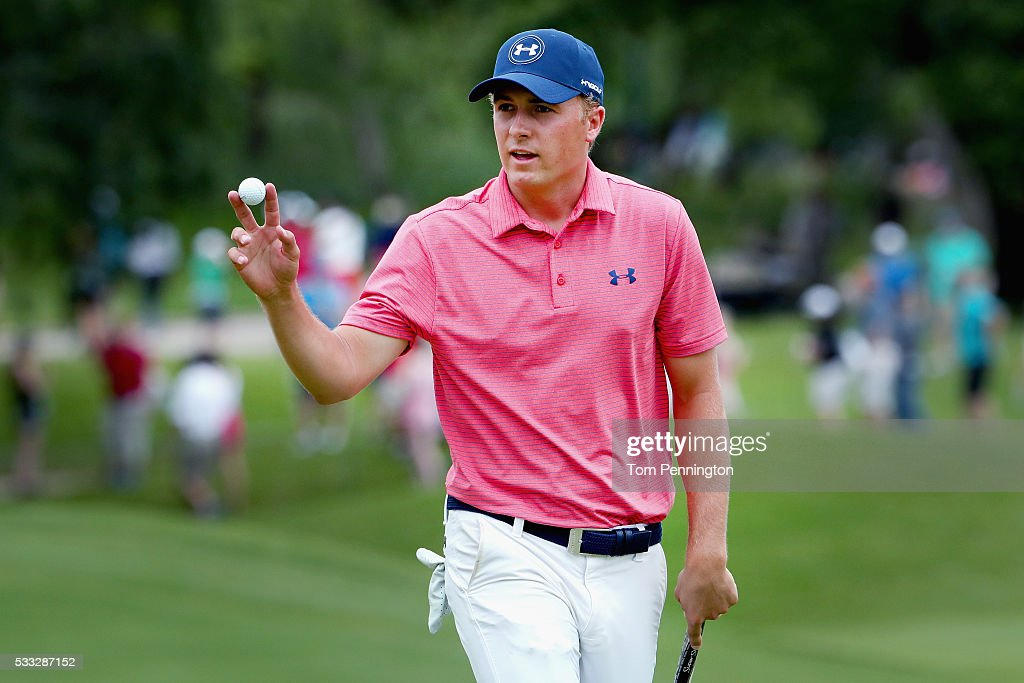 Jordan Spieth waves to the gallery on the 10th green during Round Three at the AT&T Byron Nelson on May 21, 2016 in Irving, Texas.