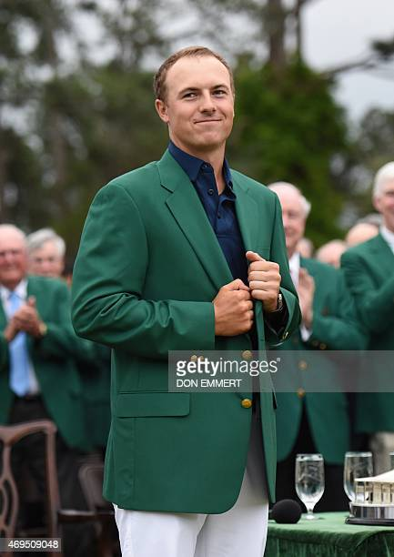 Jordan Spieth wears the Green Jacket of the 2015 Masters Champion at the 79th Masters Golf Tournament at Augusta National Golf Club on April 12 in...