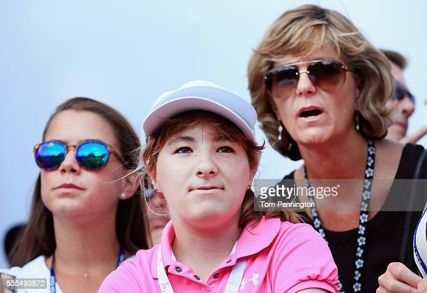 Jordan Spieth's mother Chris sister Ellie and girlfriend Annie Verret look on from the 18th green during the DEAN DELUCA Invitational at Colonial...