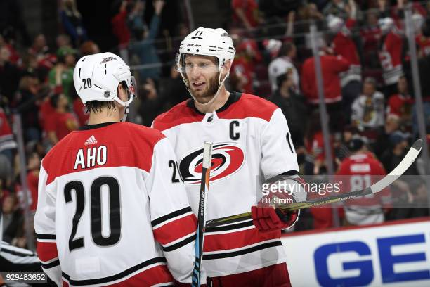 Jordan Staal and Sebastian Aho of the Carolina Hurricanes talk in the third period against the Chicago Blackhawks at the United Center on March 8...