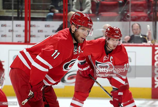 Jordan Staal and teammate Eric Staal of the Carolina Hurricanes prepare for a faceoff against the Dallas Stars during their NHL game at PNC Arena on...