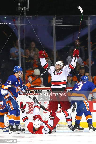 Jordan Staal celebrates with Nino Niederreiter of the Carolina Hurricanes who scored a third period goal against the New York Islanders in Game One...