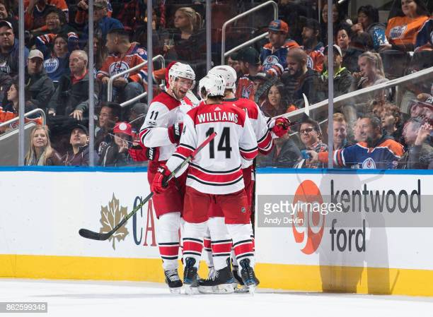 Jordan Staal Justin Williams and Jaccob Slavin of the Carolina Hurricanes celebrate a goal against the Edmonton Oilers on October 17 2017 at Rogers...
