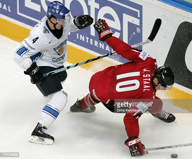 Jordan Staal of Canada fights for the puck with Villie Koistinen of Finland during the IIHF World Ice Hockey Championship final match between Canada...
