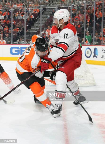 Jordan Staal of the Carolina Hurricanes battles against Corban Knight of the Philadelphia Flyers on April 6 2019 at the Wells Fargo Center in...