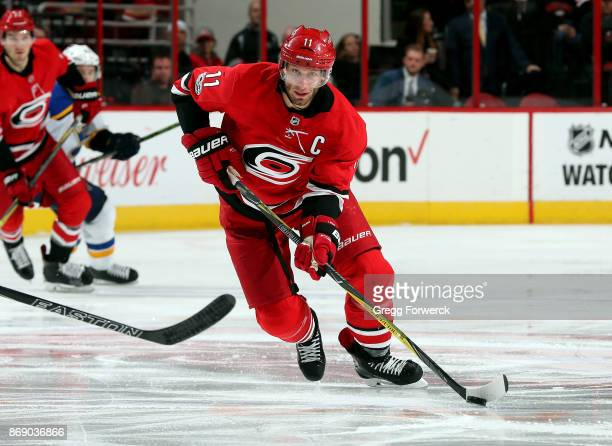 Jordan Staal of the Carolina Hurricanes carries a puck on the ice during an NHL game against the St Louis Blues on October 27 2017 at PNC Arena in...