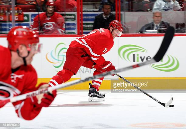Jordan Staal of the Carolina Hurricanes carries the puck down the ice on a breakaway during an NHL game against the Tampa Bay Lightning at PNC Arena...