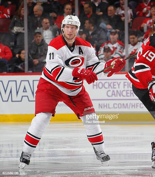 Jordan Staal of the Carolina Hurricanes checks in an NHL hockey game against the New Jersey Devils at the Prudential Center on November 8 2016 in...