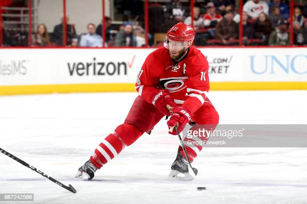 Jordan Staal of the Carolina Hurricanes controls the puck on the ice during an NHL game against the New York Islanders on April 6 2017 at PNC Arena...