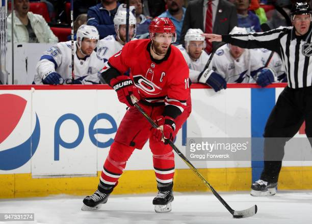 Jordan Staal of the Carolina Hurricanes controls the puck on the ice during an NHL game against the Tampa Bay Lightning on April 7 2018 at PNC Arena...
