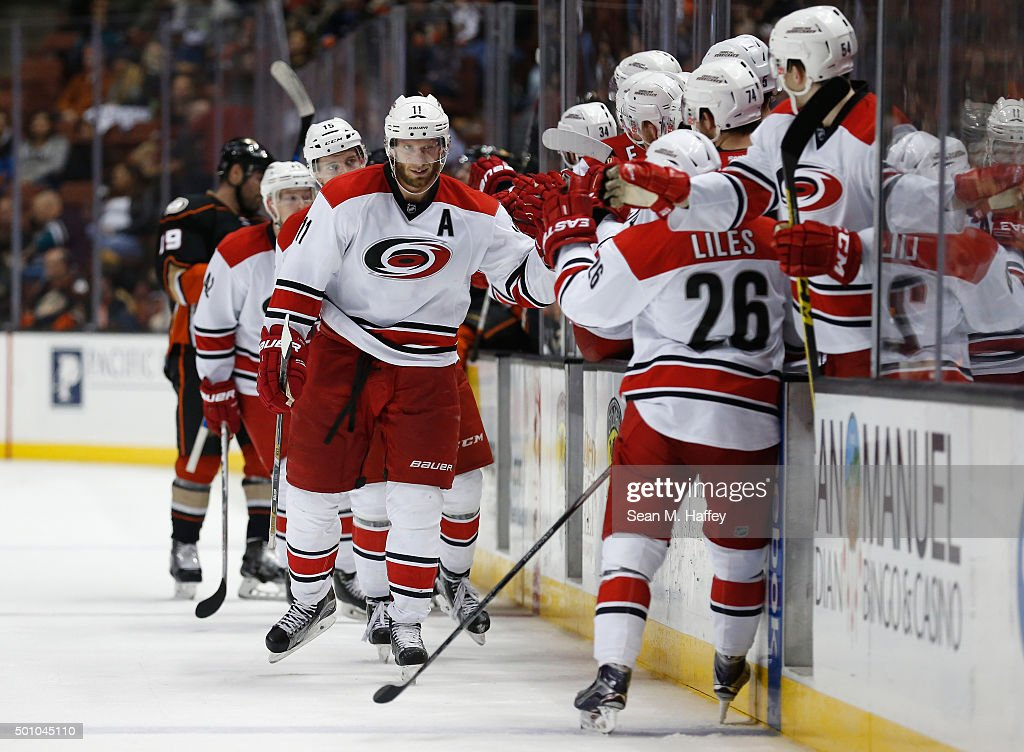 Jordan Staal #11 of the Carolina Hurricanes is congratulated by his teammates after scoring a goal during the third period of a game against the Anaheim Ducks at Honda Center on December 11, 2015 in Anaheim, California.