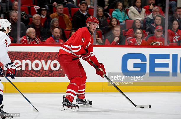 Jordan Staal of the Carolina Hurricanes looks to pass the puck during an NHL game against the Washington Capitals on December 16 2016 at PNC Arena in...