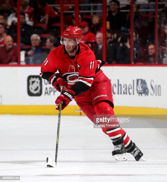 Jordan Staal of the Carolina Hurricanes moves the puck through the neutral zone during an NHL game against the Winnipeg Jets on March 4 2018 at PNC...