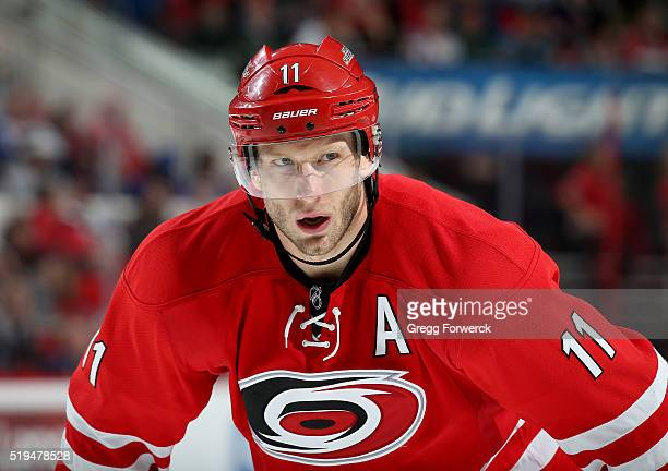 Jordan Staal of the Carolina Hurricanes prepares for a faceoff during an NHL game against the New York Rangers at PNC Arena on March 31 2016 in...