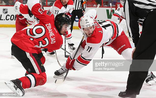 Jordan Staal of the Carolina Hurricanes prepares for a faceoff against Mika Zibanejad of the Ottawa Senators at Canadian Tire Centre on February 16...