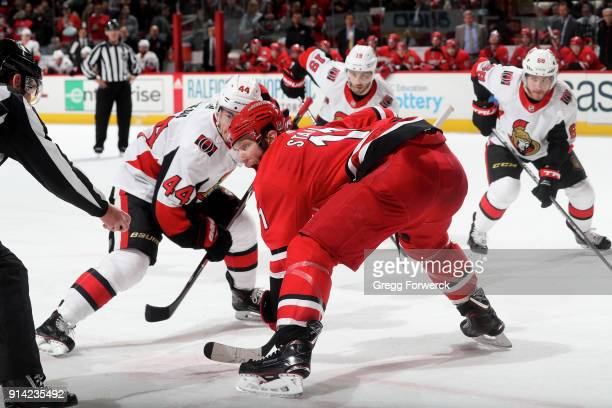 Jordan Staal of the Carolina Hurricanes prepares for a faceoff against JohnGabriel Pageau of the Ottawa Senators during an NHL game on January 30...