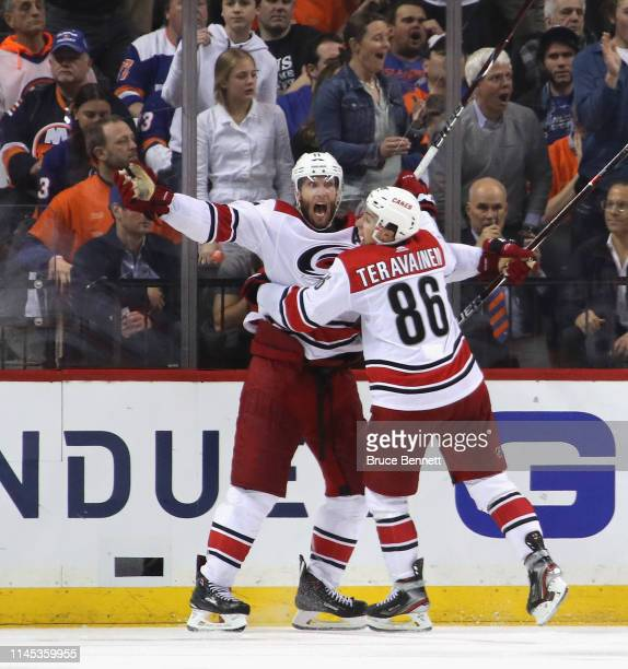 Jordan Staal of the Carolina Hurricanes scores at 404 of overtime against the New York Islanders and is joined by Teuvo Teravainen in Game One of the...