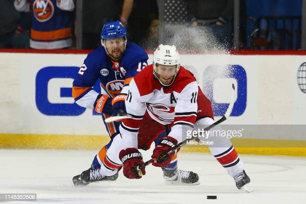 Jordan Staal of the Carolina Hurricanes skates for the puck as Josh Bailey of the New York Islanders defends him during Game One of the Eastern...