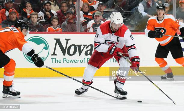 Jordan Staal of the Carolina Hurricanes skates the puck against Valtteri Filppula of the Philadelphia Flyers on March 1 2018 at the Wells Fargo...
