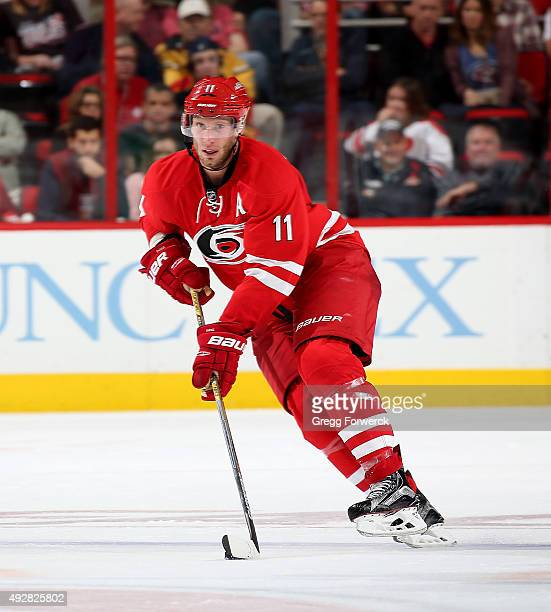 Jordan Staal of the Carolina Hurricanes skates with the puck during a NHL game against the Florida Panthers at PNC Arena on October 13 2015 in...
