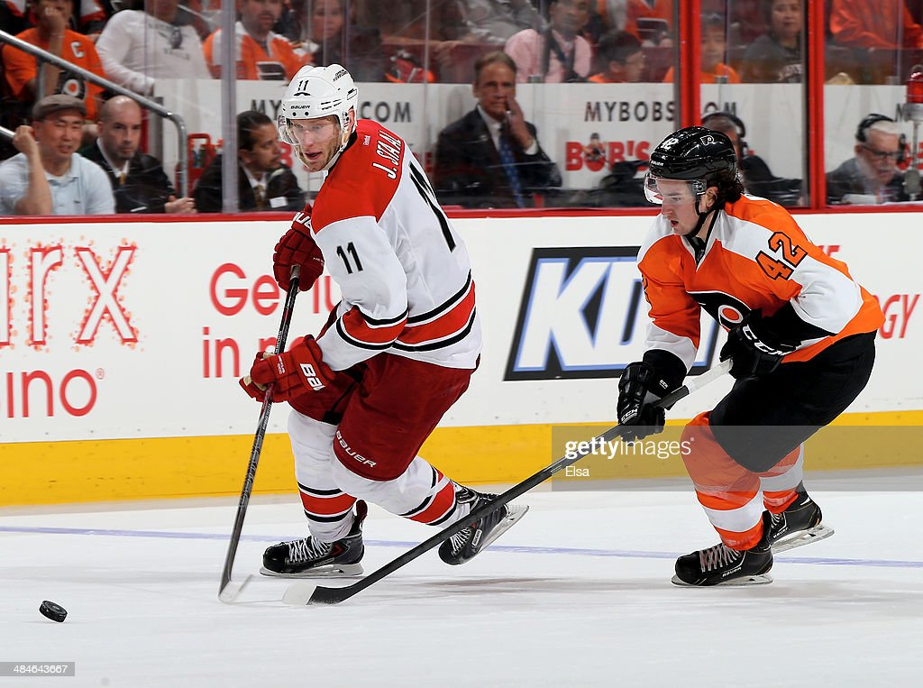 Jordan Staal #11 of the Carolina Hurricanes takes the puck as Jason Akeson #42 of the Philadelphia Flyers defends in the third period at Wells Fargo Center on April 13, 2014 in Philadelphia, Pennsylvania.The Carolina Hurricanes defeated the Philadelphia Flyers 6-5 in an overtime shootout.