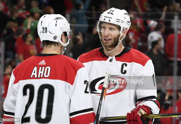 Jordan Staal of the Carolina Hurricanes talks with Sebastian Aho in the third period against the Chicago Blackhawks at the United Center on March 8...