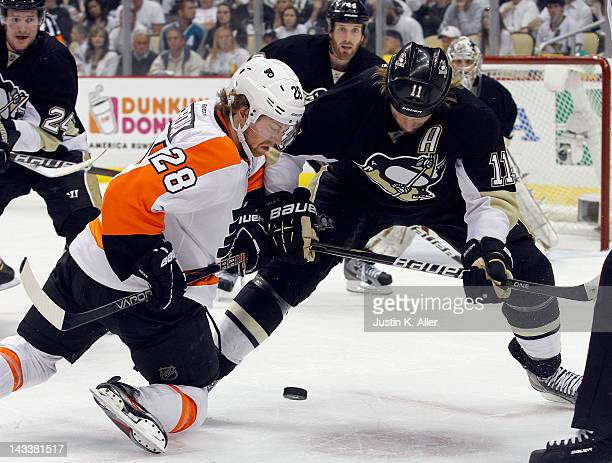 Jordan Staal of the Pittsburgh Penguins battle for a faceoff against Claude Giroux of the Philadelphia Flyers in Game Five of the Eastern Conference...