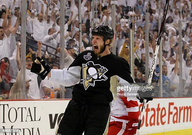 Jordan Staal of the Pittsburgh Penguins celebrates after scoring a goal in the second period against goaltender Chris Osgood of the Detroit Red Wings...