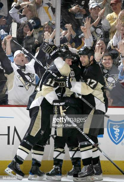 Jordan Staal of the Pittsburgh Penguins celebrates his goal with Mike Rupp against the Philadelphia Flyers on December 15 2009 at Mellon Arena in...
